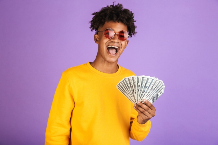 Portrait of fashion african american man wearing sunglasses smil